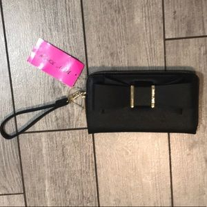 Betsey Johnson black and gold bow wristlet